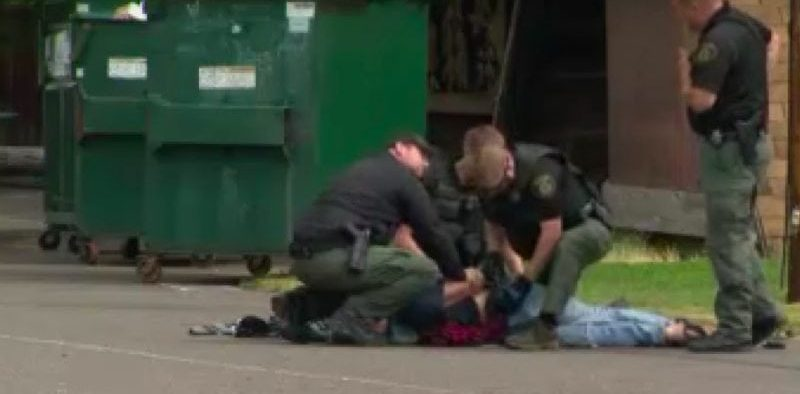 Oregon PD punch homeless man Straw