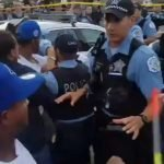 Police And Protester Clash After Police Shoot Black Barber Running From Scene