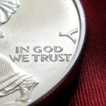 "Picture of a quarter with the motto ""In God We Trust"" on it"