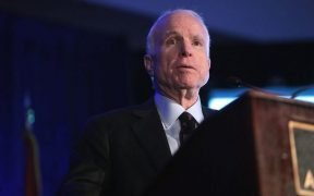 Photo of John McCain speaking at a conference in 2016