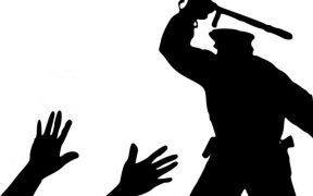 Graphic of cop silhouette with raised baton targeting someone on the ground