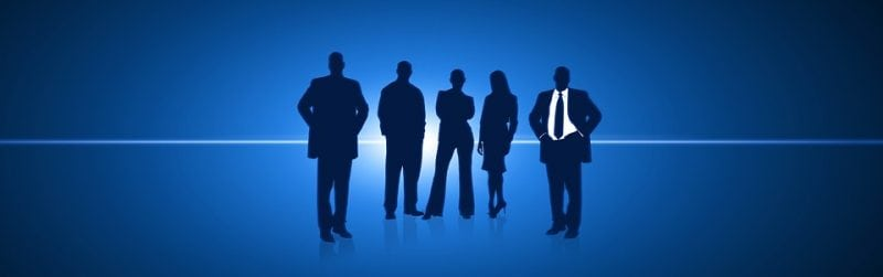 Image of five silhouettes in business attire--three men, two women.