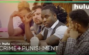 Screenshot of scene young minority men from documentary Crime + Punishment