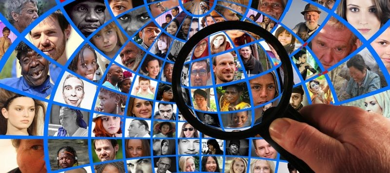 picture of magnifying glass looking at diverse population