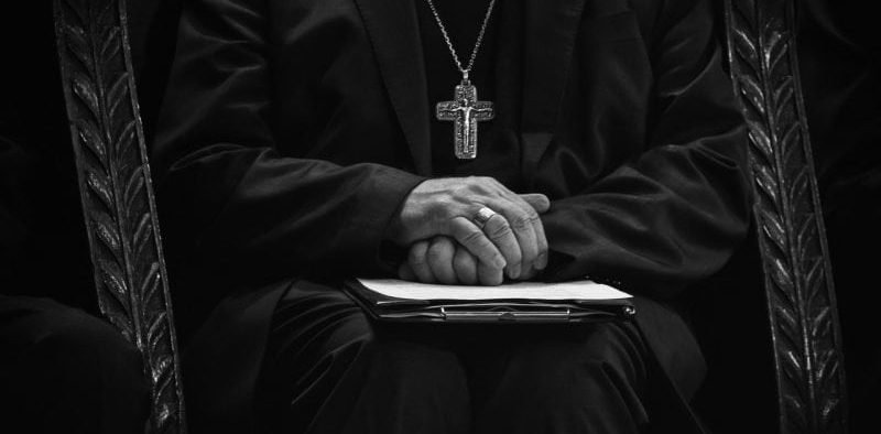 Picture of Catholic priest folding his hands
