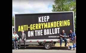 "Volunteers pose before a Represent.Us sign saying ""keep anti-gerrymandering on the ballot"""