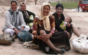 photo of Uighur women sitting on dusty road in old city Kashgar, 2009