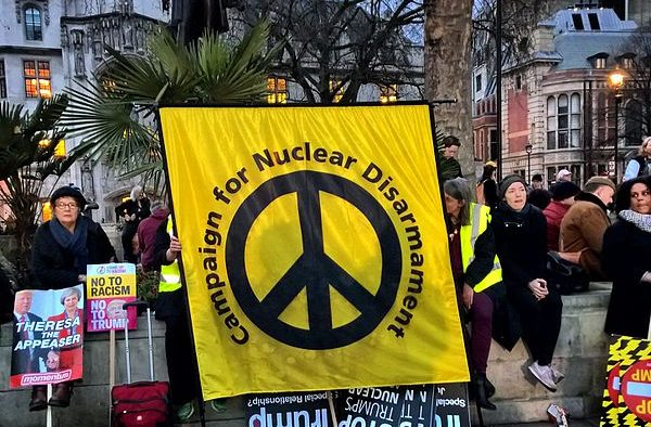 Photos taken at the Stop Trump rally at London's Parliament Square on Monday 20th February 2017. The peace sign is used in the Campaign for Nuclear Disarmament's banner. (Photo: Garry Knight)
