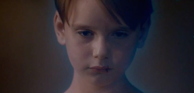 screenshot of a young boy, from the trailer for A Child's Voice