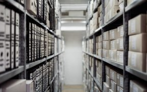 Photo of a warehouse aisle with boxes.