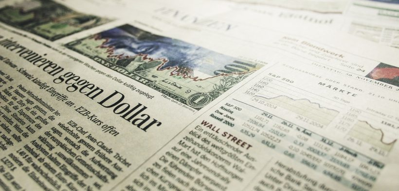 Photo of the front page of the financial section of a newspaper