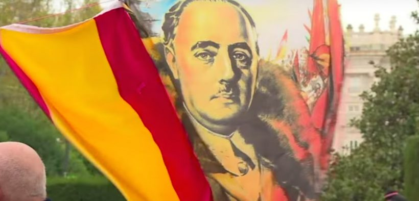 Photo of a flag commemorating Francisco Franco at a rally in support of him.