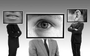 photo of television screens spying on people