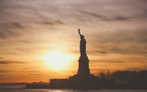 photo of the statue of liberty at sunset