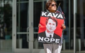 photo of woman holding Kavanope sign