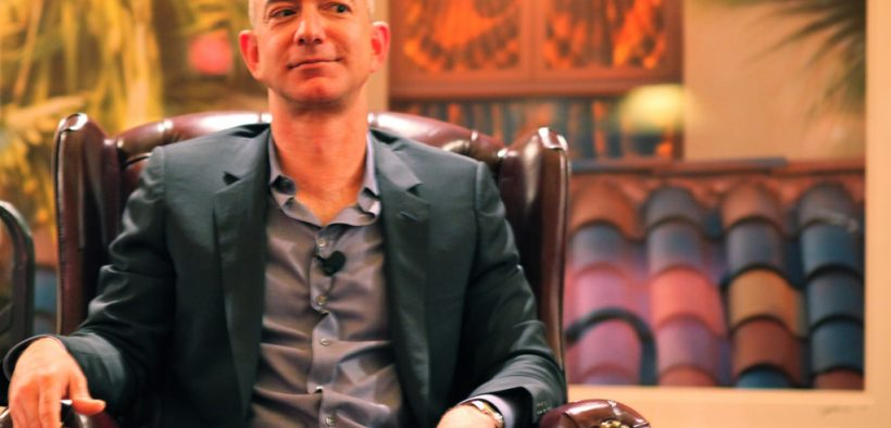 Amazon's founder Steve Jobs sitting in a chair glancing sideways. Bezos announced an Amazon pay raise to $15/hour