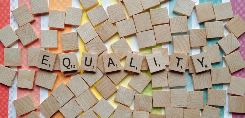 photo of a the word Equality spelled out in scrabble ladders on a rainbow back drop. LGBT inclusivity in education