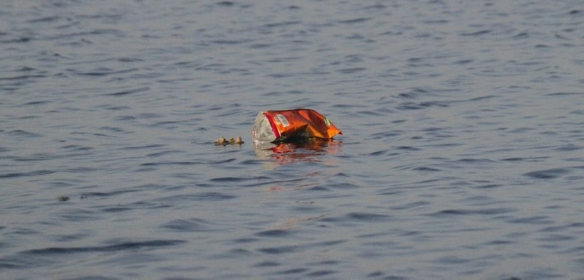 photo of trash floating in the ocean