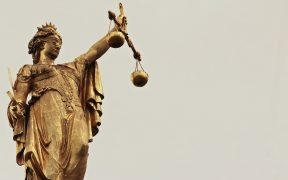 photo of the lady justice statue. Washington state overturned the death penalty