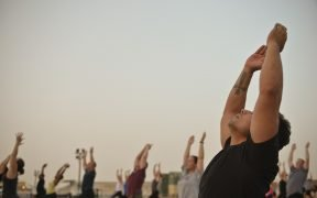 male yoga class. researchers are studying how yoga could help prison inmates