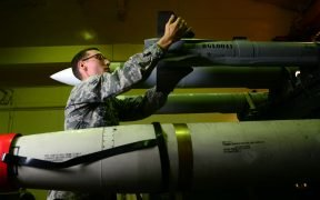 Airman 1st Class Nathan Roberts, 35th Maintenance Squadron precision guided munitions crew member, inspects the tail of an AIM-9X Missile before delivering it to an F-16 Fighting Falcon at Misawa Air Base, Japan, June 11, 2014.
