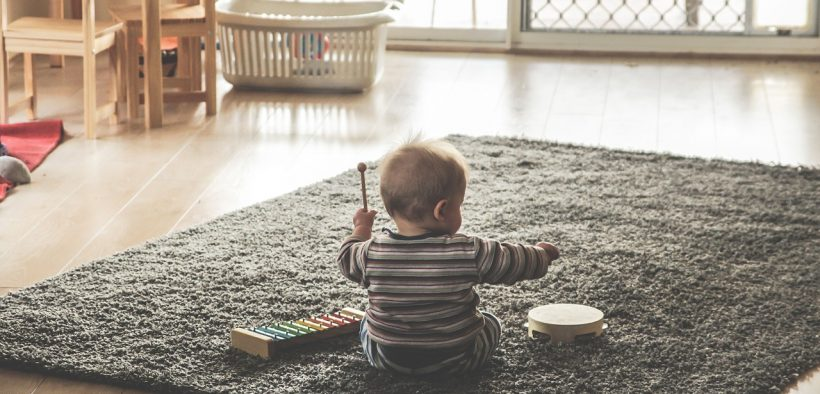 photo of a child playing in a living room