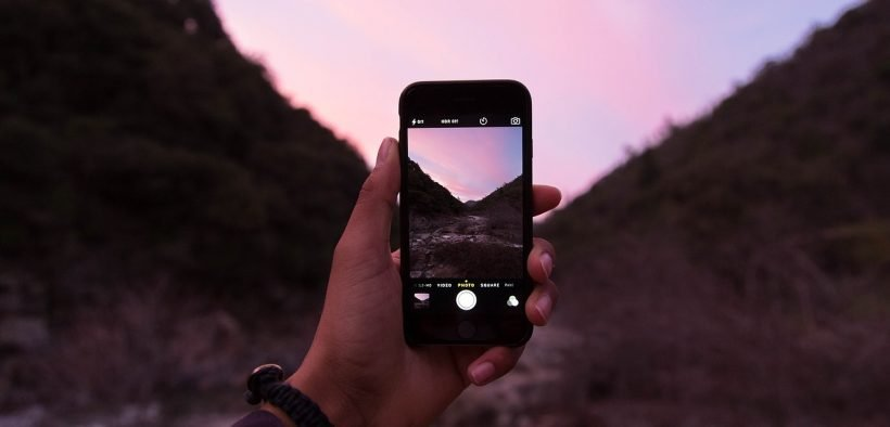 photo of someone holding a cell phone outdoors. A new Gizmodo article explains how Do Not Track does nothing on your phone.