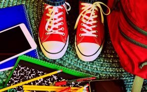 photo of school supplies and kids sneakers