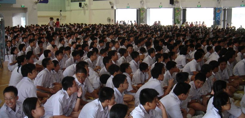 Photo of students of Nan Hua High School, Singapore, gathering in the school hall.