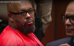 Suge Knight in orange prison jump suit at his hearing