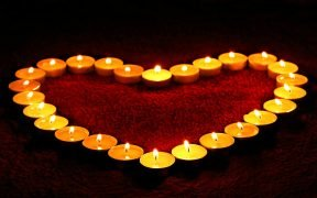 tea candles lit in a heart shape