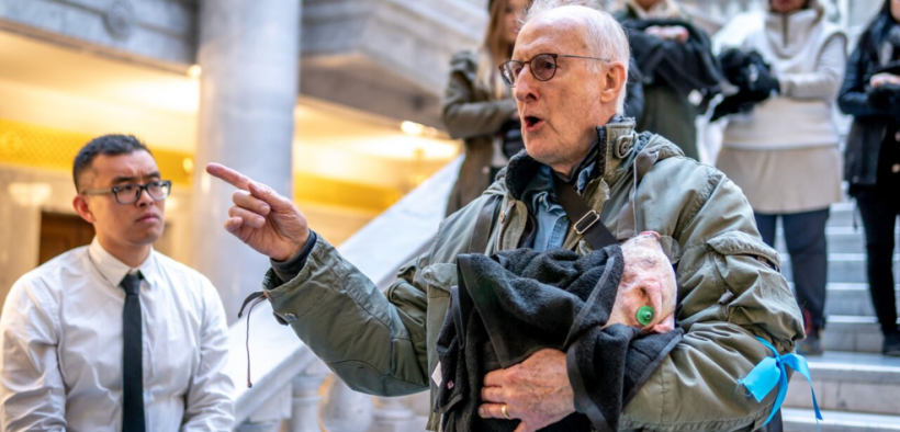 Actor James Cromwell was among animal rights protesters who held stiff carcasses of dead piglets as they demonstrated at the Utah Capitol, calling on state officials to prevent cruelty at farms and investigate health risks associated with large-scale agriculture. (Photo courtesy of DxE)