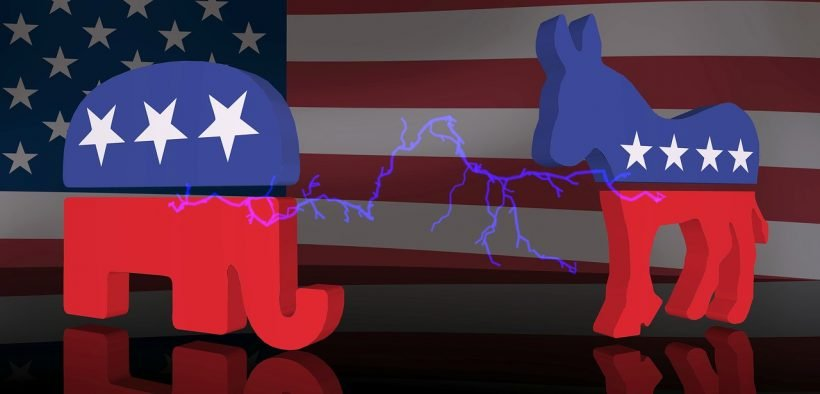 Logos of Democrat and Republican party against a US flag