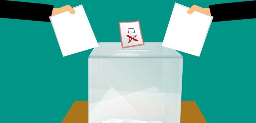 graphic of two ballots placed into a voting box