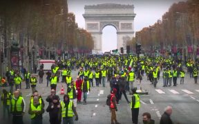 protestors wearing yellow vests in France