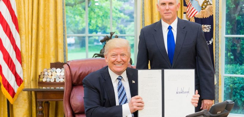President Donald J. Trump, joined by Vice President Mike Pence, displays his signed Executive Order for the Establishment of a Presidential Advisory Commission on Election Integrity, Thursday, May 11, 2017, in the Oval Office of the White House in Washington, D.C.