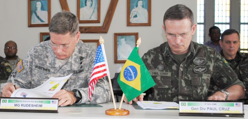 Maj. Gen. Frederick S. Rudesheim, the commanding general of U.S. Army South, and Brazilian Lt. Gen. Luiz Guilherme Paul Cruz, deputy chief for Special and International Affairs of the Brazilian army, sign a memorandum of understanding during the closing ceremony of the army-to-army staff talks between the U.S. and Brazilian armies May 22, 2013 in Manaus, Brazil.