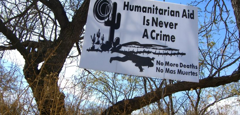"a sign reading ""humanitarian aid is never a crime"" hanging on a farm in Arizona in 2005"