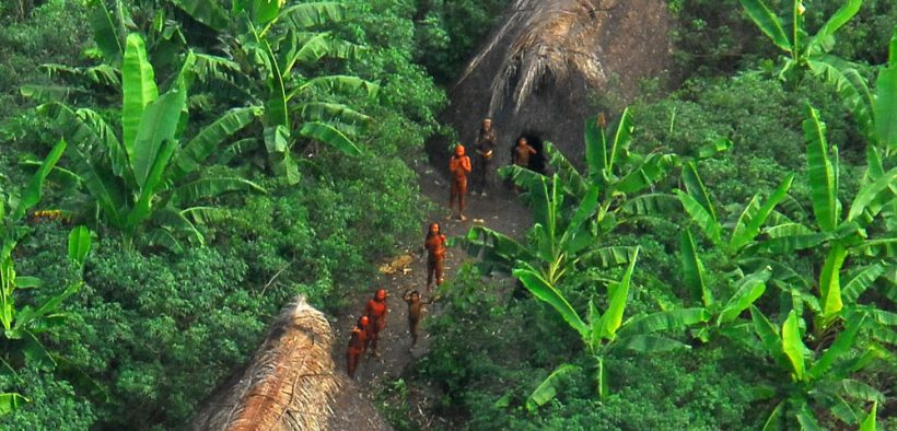 An uncontacted tribe in Brazil looks up towards the sky.