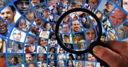 magnifying glass looking at a screen full of people's faces