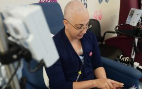 A staff sergeant reads an eBook during her chemotherapy treatment at Tripler Army Medical Center in Honolulu, Hawaii, Feb. 26, 2014.