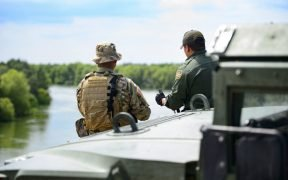 A Texas National Guardsman and a Customs and a Border Protection agent discuss the border security mission on the shores of the Rio Grande River in Starr County, Texas, April 10, 2018. The National Guard presence is part of the federal call-up to support the Department of Homeland Security in securing the border.