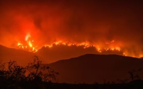 Hillside covered in red fire, Whittier Fire, evening of July 13, 2017.