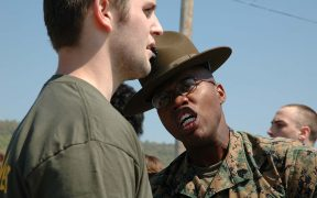 Sergeant Paul Nixon, drill instructor, 3rd Recruit Training Battalion, Marine Corps Recruit Depot Parris Island, South Carolina, gives a poolee some added incentive to do what he's told.