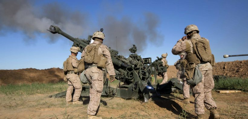 FIRE BASE BELL, Iraq - U.S. Marines with Task Force Spartan, 26th Marine Expeditionary Unit (MEU), on Fire Base Bell, Iraq, fire an M777A2 Howitzer at an ISIS infiltration route March 18, 2016. (Photo by Cpl. Andre Dakis)