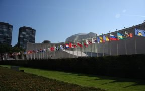 Row of flags in front of the UN General Assembly building, Manhattan, New York.