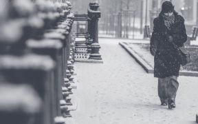 Woman walking in a blizzard.