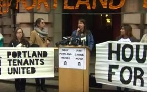 Oregon residents holding a rally to pass Oregon rent control statewide. (Photo via YouTube)