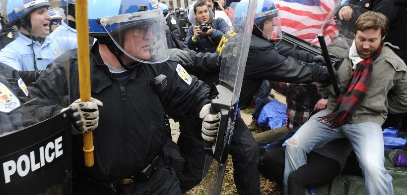 "U.S. National Park Service police clear protesters to erect barricades as they empty the Occupy DC encampment in McPherson Square in Washington, February 4, 2012. Police officers wearing helmets and carrying shields arrived at the site where protesters with the ""Occupy"" movement have been staging a demonstration since October, but it was not immediately clear whether they would evict the protesters. REUTERS/Jonathan Ernst (UNITED STATES - Tags: POLITICS CIVIL UNREST)"
