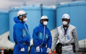 Workers are seen in front of storage tanks for radioactive water at Tokyo Electric Power Co's (TEPCO) tsunami-crippled Fukushima Daiichi nuclear power plant in Okuma town, Fukushima prefecture, Japan February 18, 2019. Picture taken February 18, 2019. REUTERS/Issei Kato